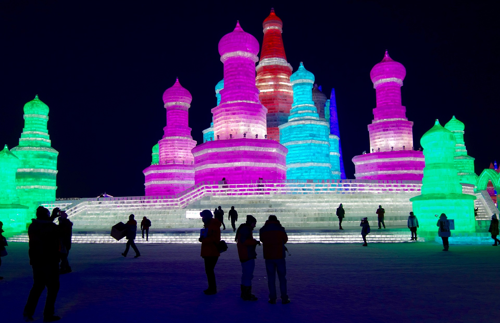 A picture of ice scupltures backlit by colored lights.